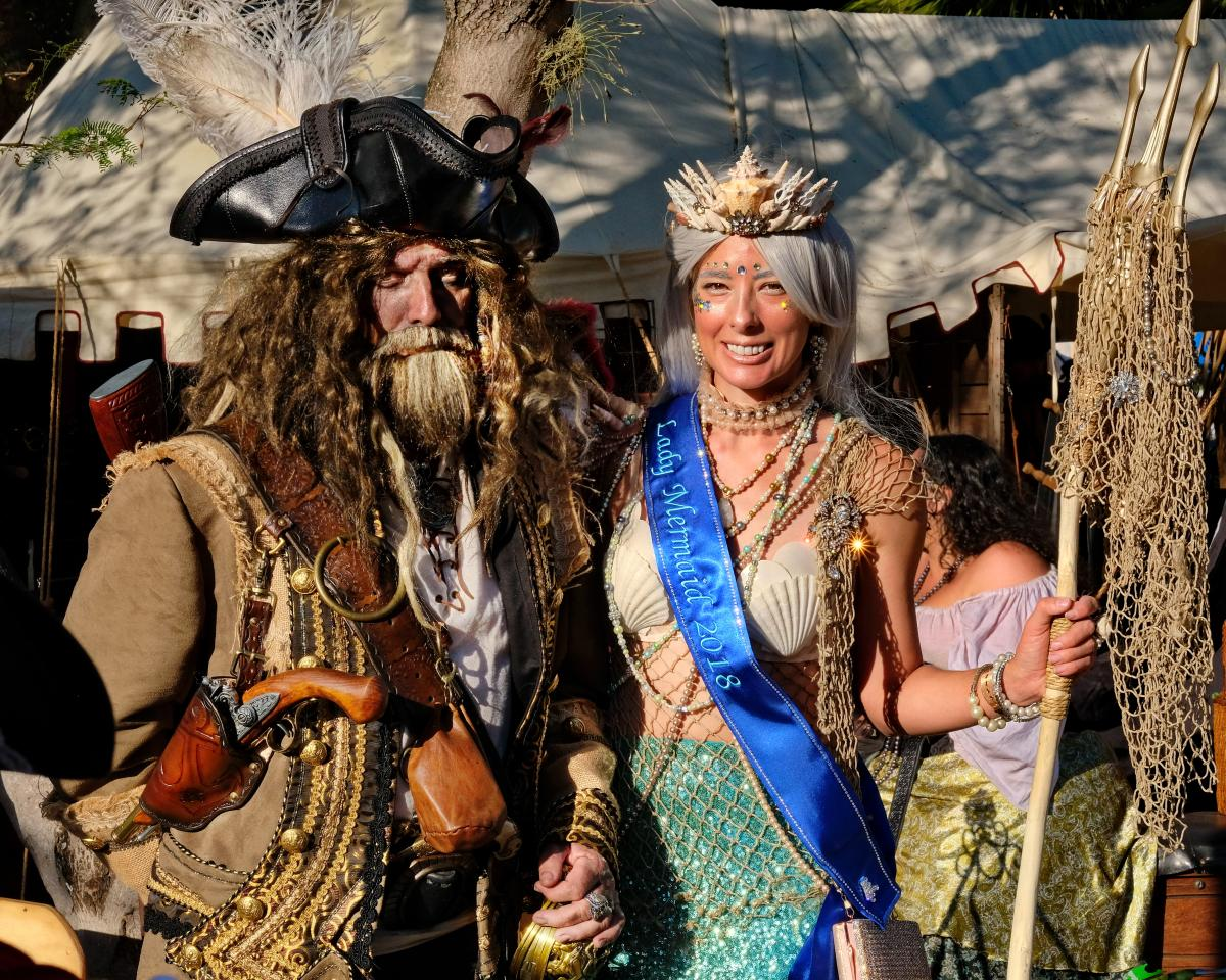 Man dressed like pirate and women dressed as a mermaid