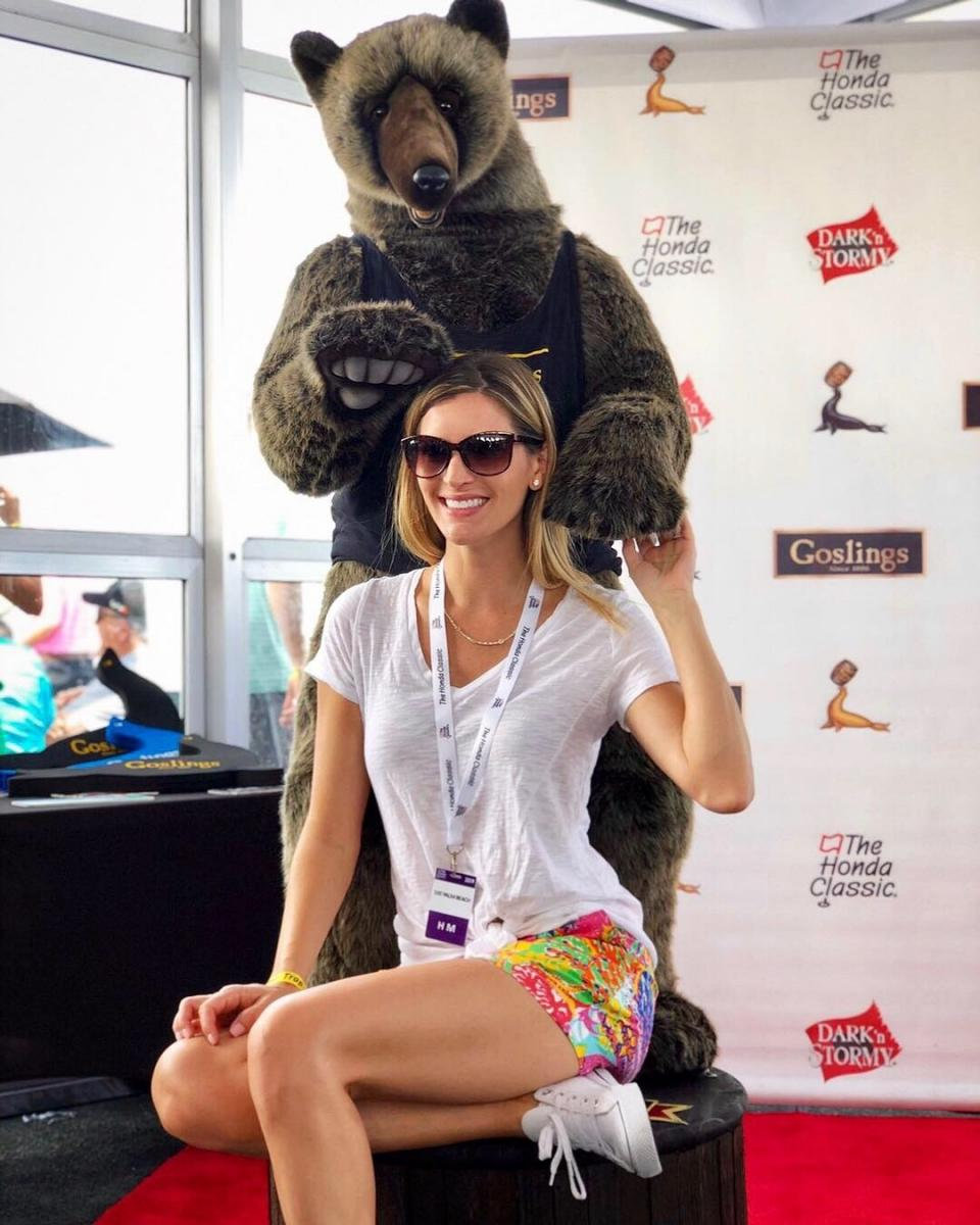 Godlings Tent at the Honda Classic Cristyle taking picture with a Bear