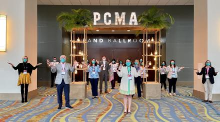 Men and Woman standing socially distanced in the Palm Beach County Convention Center