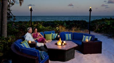 Couple enjoying the Jupiter Beach Resort & Spa firepit