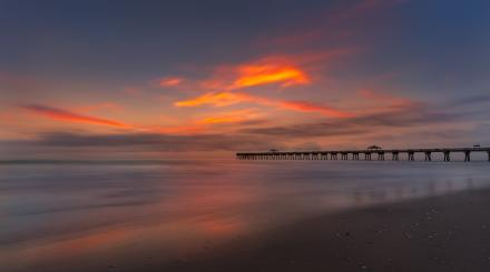 Sunrise over Juno Pier