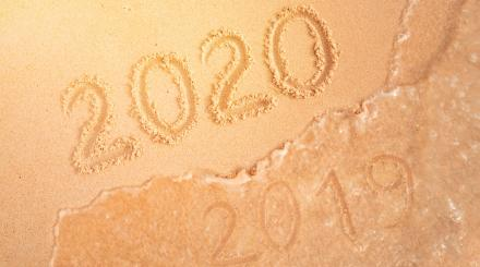 2020 written in beach sand