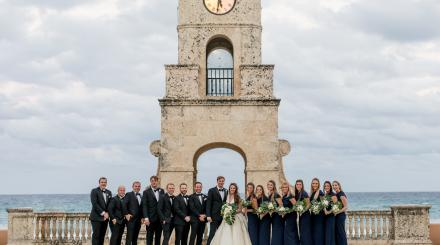 Wedding party photo in front of the Worth Avenue Clock Tower, Palm Beach © Kelilina Photography