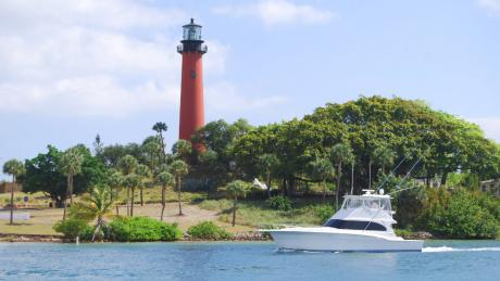 lighthouse with boat