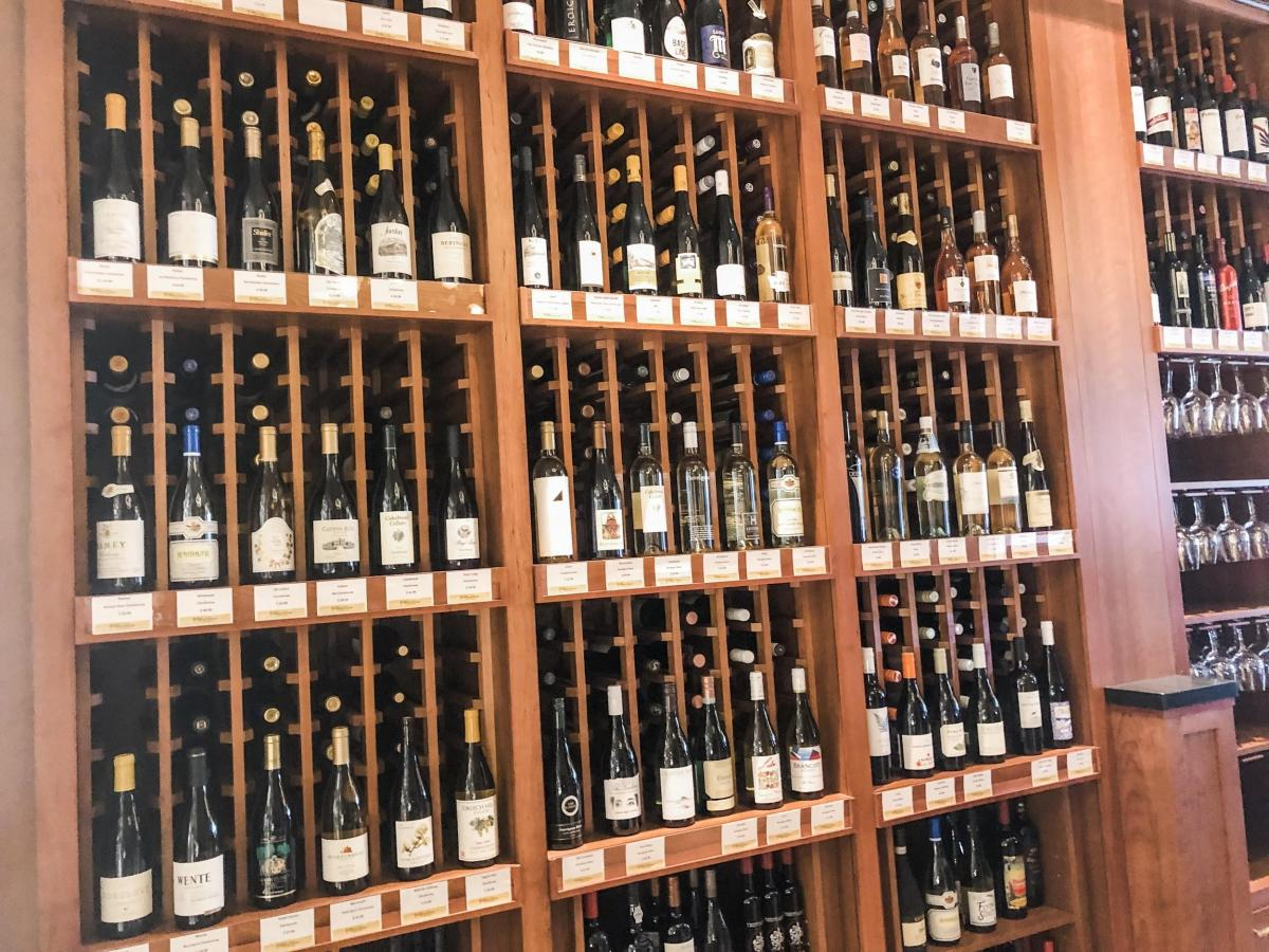 Inside a wine room with various bottles on display