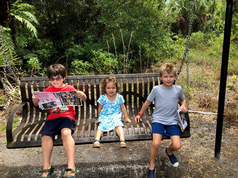 Kids sitting on a bench in a park
