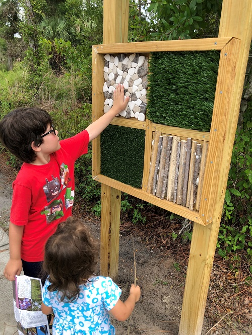 Kids touching a sensory wall