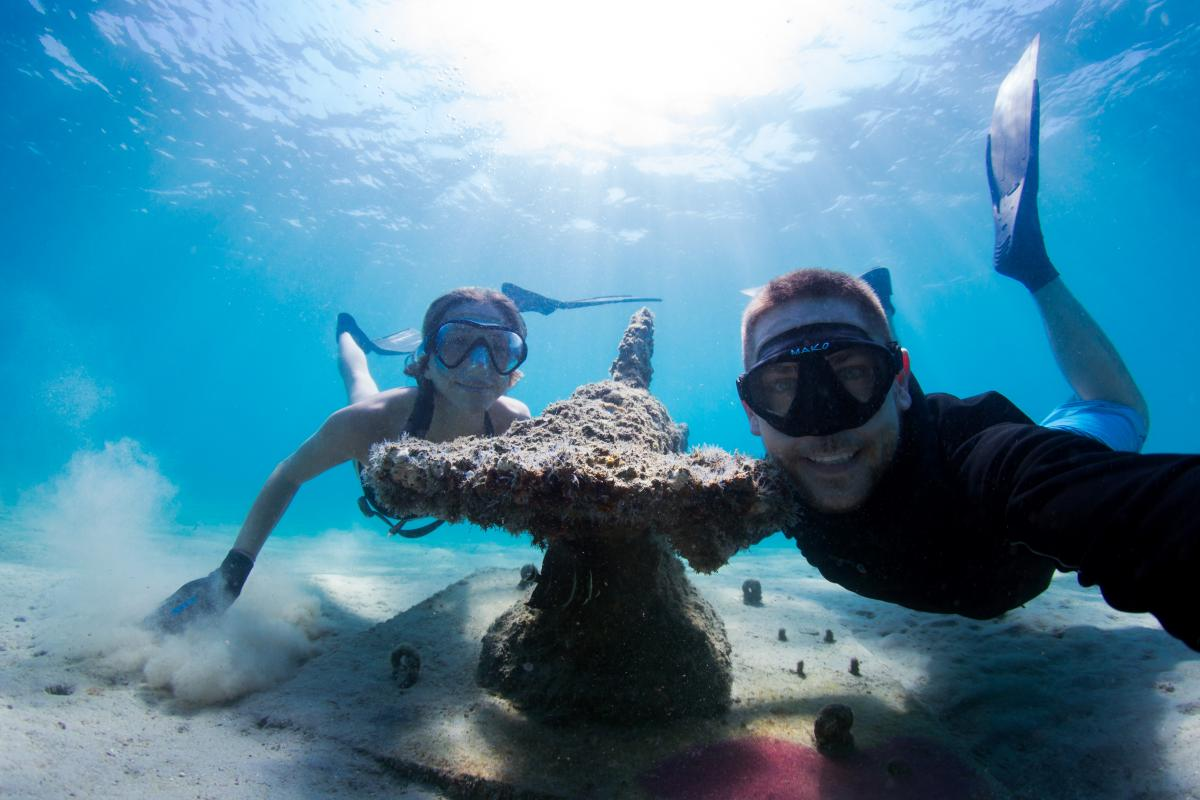 Underwater Snorkel Trail selfie with one of three hammerhead shark statues Photo (courtesy Mike Scott Photography) can be downloaded by clicking here