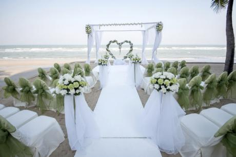 Wedding on the beach with chairs