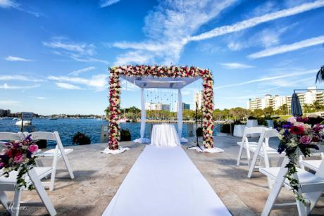 Outdoor Ceremony overlooking the Water - The 4 Diamond Waterstone Resort & Marina- offers a one of a kind view for outdoor ceremonies overlooking Lake Boca.  Plan your Wedding with us!