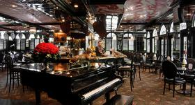 The-Leopard-Lounge-at-The-Chesterfield-Palm-Beach early 20th-century grand colonial style, the restaurant's jet-black lacquered walls, leather booths, punkah fans and hand-painted ceiling set the tone for the kind of experience