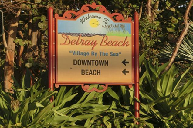 Village By The Sea sign