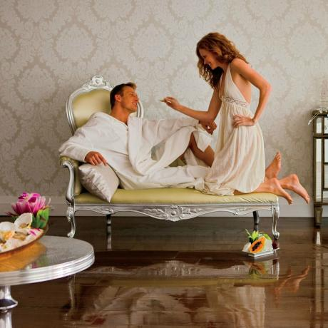 Romantic couple with oyster in a hotel villa