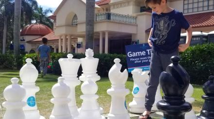 Boy Playing Giant Chess at Mizner Park