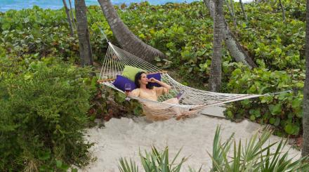 Lady in hammock on beach