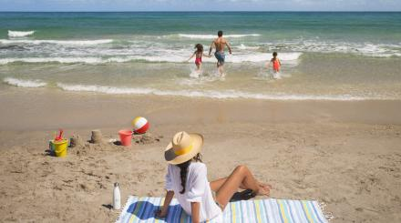 Family enjoying the beach in The Palm Beaches