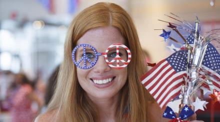 Festive woman holding patriotic items